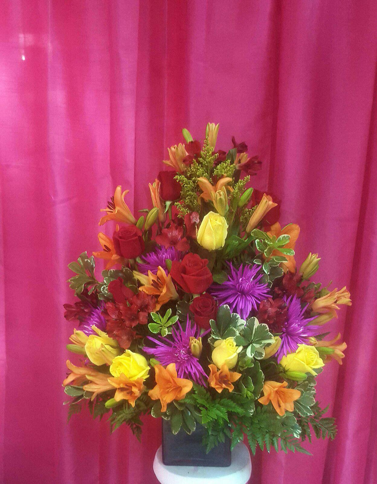 Tropical flowers in squared vase iris florist tropical flowers in squared vase izmirmasajfo
